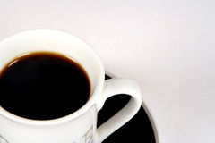 Cup of black coffee. On saucer Royalty Free Stock Image