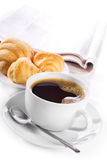 Cup of black coffee. Croissants and newspaper Royalty Free Stock Photos