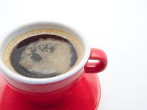 Cup of black coffee. Black coffee in red cup and saucer Royalty Free Stock Photography