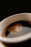 Cup of black coffee. Closeup of cup of black coffee with studio background and copy space Royalty Free Stock Photo