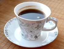 Cup of black coffee. On bamboo mat royalty free stock images