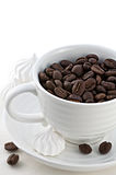 Cup with black coffee beans close-up Stock Photography