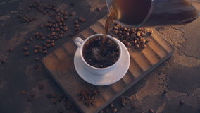 Cup of black coffee and beans over grunge wooden table stock video footage