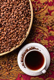 Cup of black coffee and  beans Stock Photos