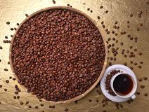 Cup of black coffee and  beans Stock Images