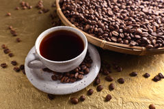 Cup of black coffee and  beans Royalty Free Stock Photos