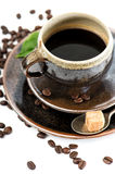 Cup of black coffee with beans on white background Stock Images