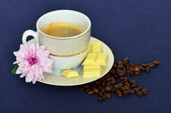 Cup of black coffee, beans, white chocolate Royalty Free Stock Photography