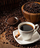 Cup of Black Coffee with Beans Royalty Free Stock Photo