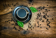 Cup of black coffee with beans on wooden background Stock Photo