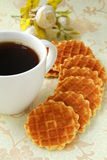 Cup of black coffee and Belgian waffles royalty free stock image