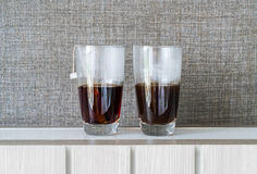 a cup of black coffee and black tea Stock Photos