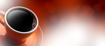 Cup of black coffee on bokeh background. Royalty Free Stock Photo