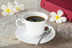 Cup of black coffee and book on table Stock Photography