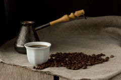 Cup of black coffee, brewing pot and coffee beans Royalty Free Stock Photography