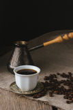Cup of black coffee, brewing pot and coffee beans Stock Photography