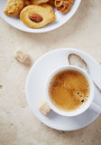 Cup of black coffee with brown sugar Stock Photos