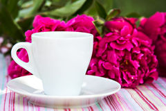 Cup of black coffee and burgundy peony. Composition with cup of a black coffee and burgundy peony Stock Photography