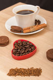 A cup of black coffee and chocolate biscuits Stock Images