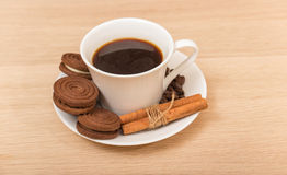 A cup of black coffee and chocolate biscuits Stock Image