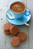 A cup of black coffee and chocolate biscuits Stock Photography
