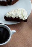 Cup of black coffee with chocolate cake Stock Images
