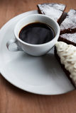 Cup of black coffee and chocolate cake Stock Images