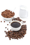 Cup of black coffee, chocolate flakes and milk isolated on white Royalty Free Stock Photography