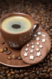 Cup of black coffee and Christmas cookies Stock Images