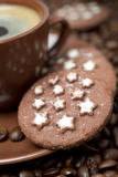 Cup of black coffee and Christmas cookies on the coffee beans Royalty Free Stock Images