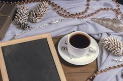 A cup of black coffee in Christmas decor and a slate with free space for text. Top view Royalty Free Stock Photos