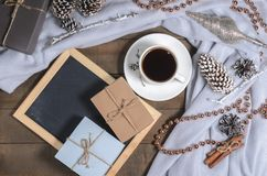 A cup of black coffee in Christmas decor and a slate with free space for text. Top view Stock Images