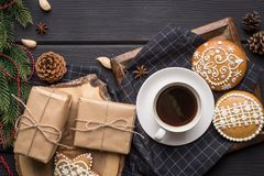 Cup of black coffee with Christmas gingerbread cookies. On black wooden background Royalty Free Stock Photos