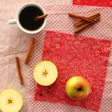 Coffee and apples. A cup of black coffee with cinnamon Royalty Free Stock Image