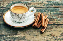 Cup of black coffee with cinnamon spices. Creative food Stock Photography