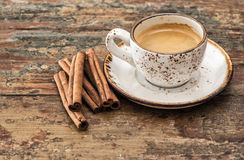 Cup of black coffee with cinnamon spices. Vintage style Royalty Free Stock Images