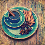 Cup of black coffee with cinnamon and star anise spices Stock Photos