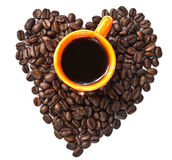 Cup of black coffee and Coffee beans arranged in heart shape Stock Photography
