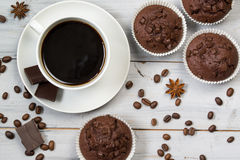 Cup of black coffee, coffee beans and chocolate muffins, top view Stock Photography
