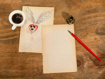 Cup of black coffee with coffee beans heart with wings drawn in pencil. Stock Photo