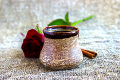 Cup of black coffee with coffee beans, red rose . Cup of black coffee with coffee beans, red rose, on sackcloth Royalty Free Stock Photo