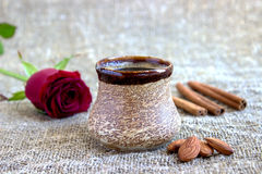 Cup of black coffee with coffee beans, red rose . Cup of black coffee with coffee beans, red rose, on sackcloth Royalty Free Stock Photos