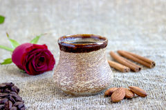 Cup of black coffee with coffee beans, red rose . Cup of black coffee with coffee beans, red rose, on sackcloth Stock Photo