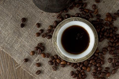 Cup of black coffee and coffee beans top view Stock Photos