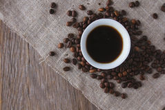 Cup of black coffee and coffee beans top view Stock Image