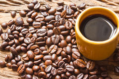 Cup of black coffee and coffee beans on  wooden Royalty Free Stock Image