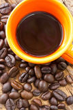 Cup of black coffee and coffee beans on wooden Stock Photos