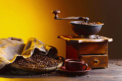 Cup of black coffee , coffee grinder and roasted beans Royalty Free Stock Photo