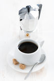 Cup of black coffee and coffeemaker Royalty Free Stock Image