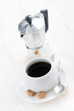 Cup of black coffee and coffeemaker, vertical Royalty Free Stock Image